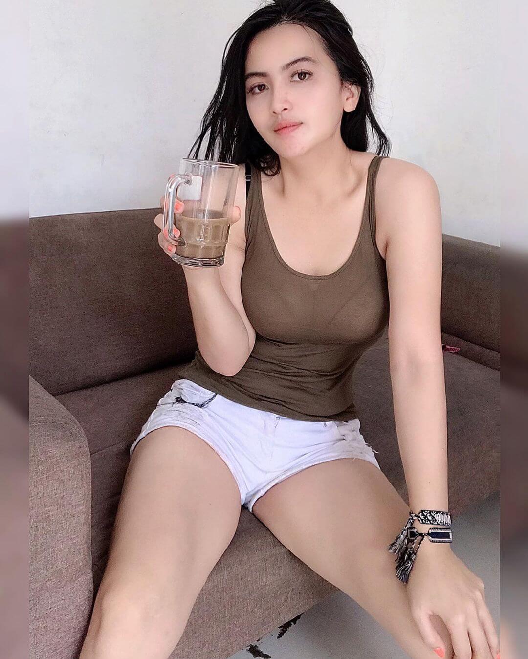 Dianna Dee Starlight Holding Glass Of Coffee