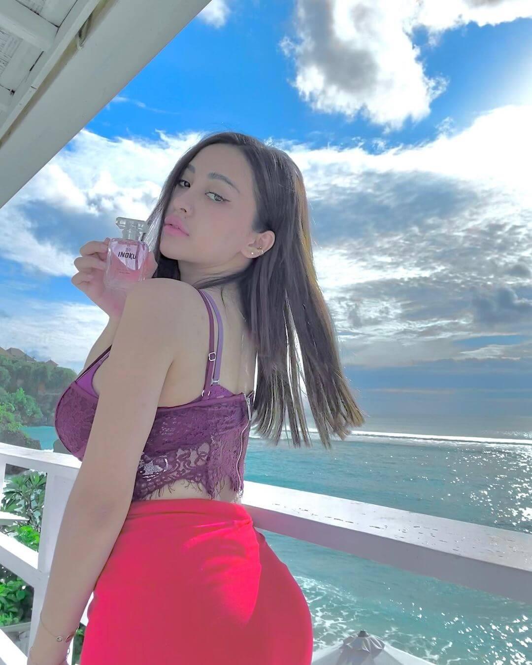 Indonesian Singer Cupi Cupita In Red Skirt
