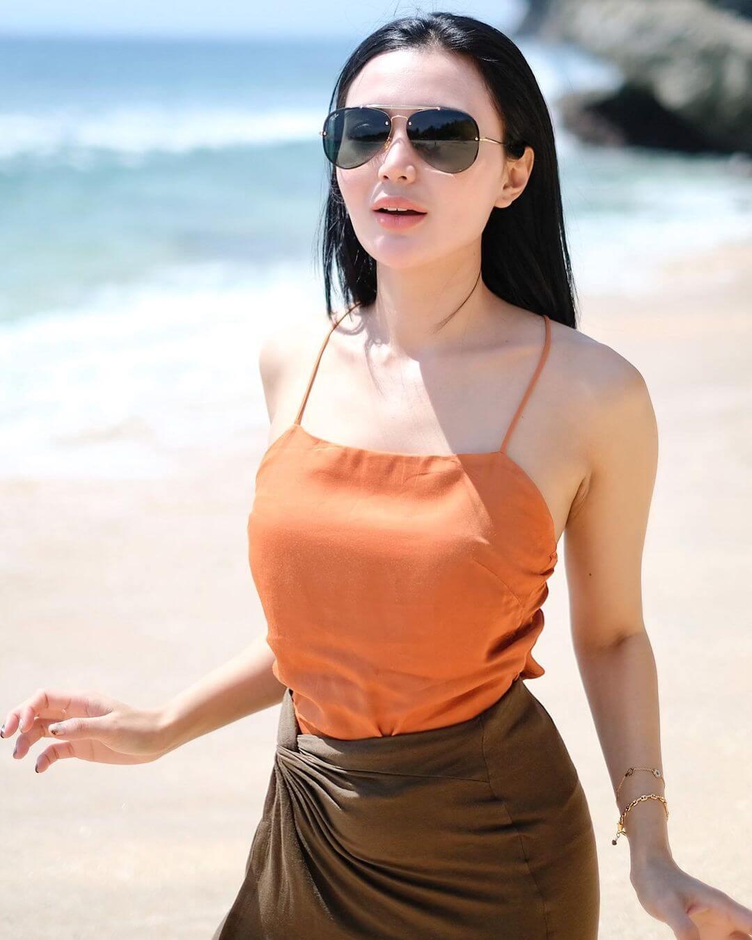 Wika Salim In Orange Color Top